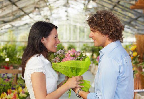 couple in flower nursery