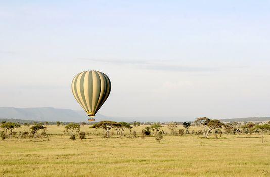 Hot air balloon flying over Serengeti National Park, Tanzania