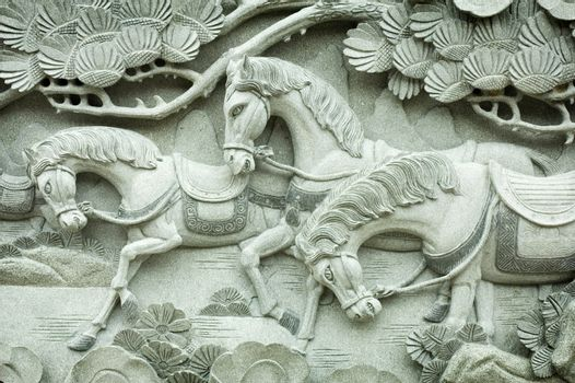 Carving on buddhism temple wall
