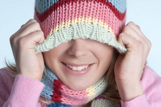 Playful winter beanie hat girl