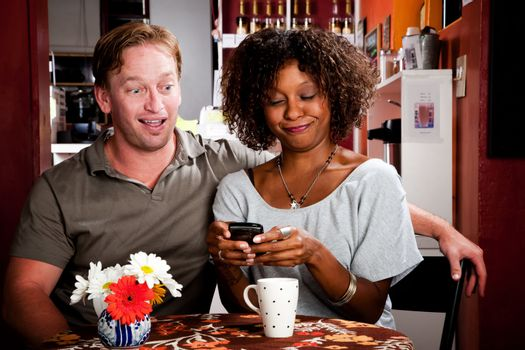 Mixed Race Couple with Handheld Phone
