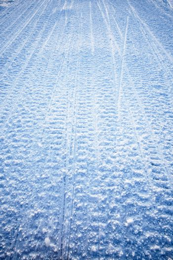 Snow texture background from snowmobile tracks