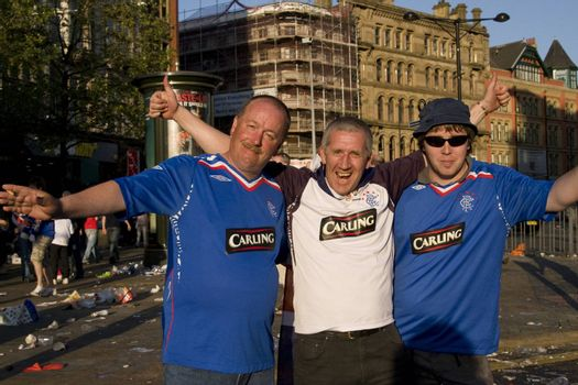 three Rangers fan supporters partying before the uefa cup match