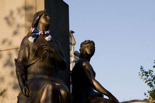 Rangers fan placed a scarf on a statue on Manchester Piccadilly