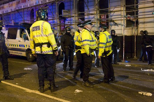 Police in newton Street manchester after the riots that took place after the UEFA football cup with the Glasgow rangers following a screen failure on Piccadilly gardens