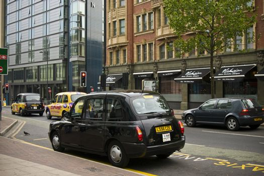 Hackney cabs on a street of Manchester