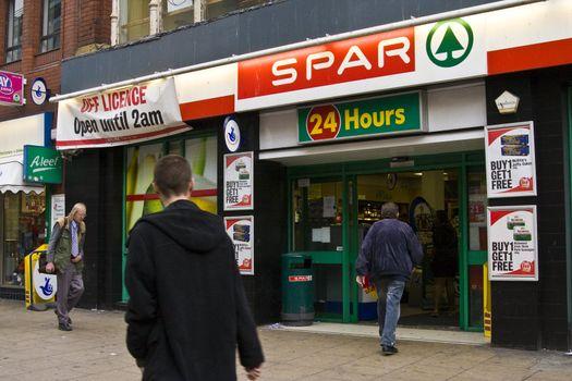 People entering the a spar shop