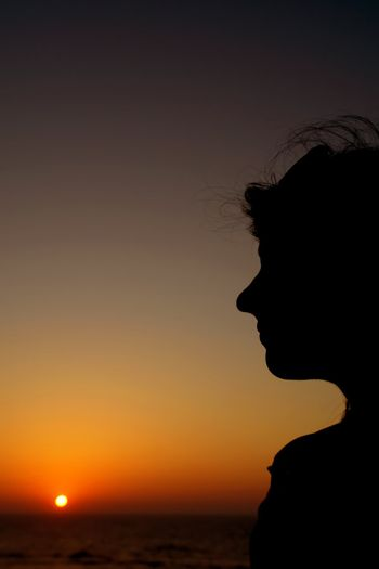 woman silhouette at sunset