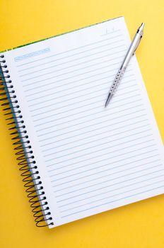 copybook and pen