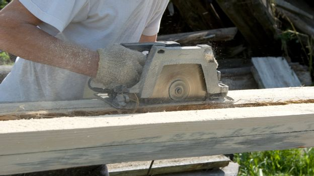 The person works as a power saw