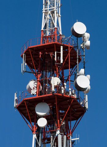 Red and white TV tower with communication antennas