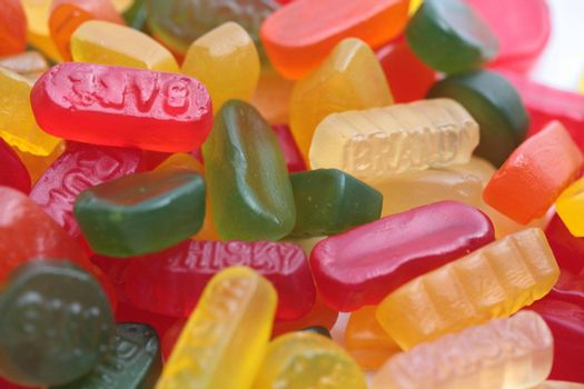 pile of assorted candy: liquorice allsorts, wine gums