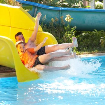The father with the son on waterslide...