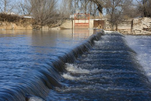 a dam on South Platte River in Colorado near Greeley diverting water for farmland irrigation
