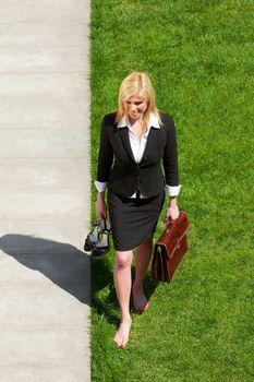 businesswoman walking barefoot