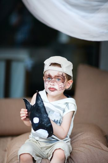 Boy with face painted