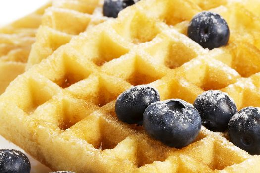 waffels with blueberries and syrup