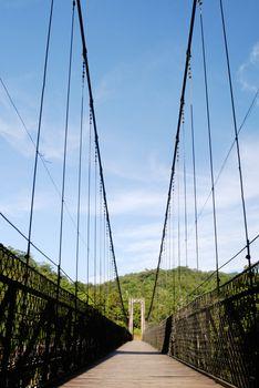 old suspension bridge with blue sky