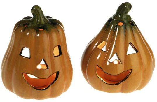 two ceramic pumpkins with a light candle inside