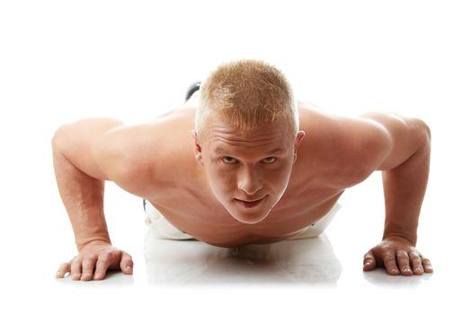 Sexy muscular man exercising