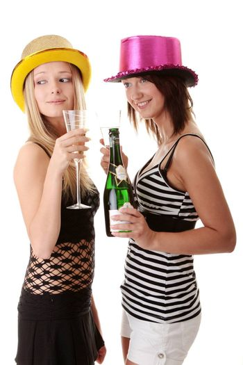 Two casual young women enjoying champagne in new yers eve