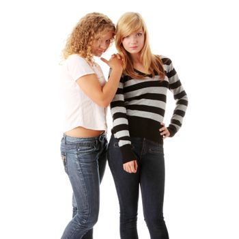 Two beautiful blond teen girlfriends isolated on white background