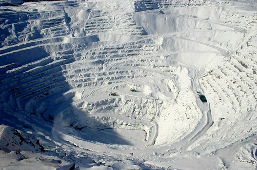 View of snow covered mining steps in open pit