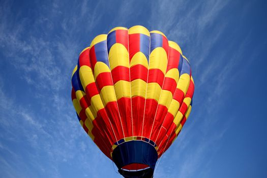 Hot air balloon on blue background with red blue and yellow highlights.