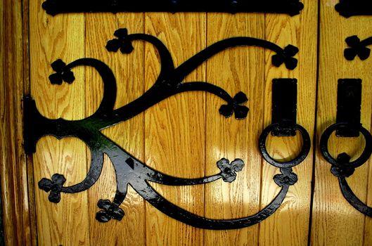 Details of iron hinge on a church door