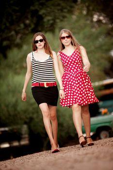 Fashion Girls Walking on Dirt Road Towards Camera