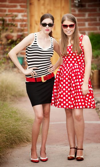 Fashion Girls on Walkway in front of House