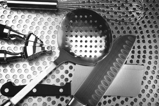 Kitchen utensils on stainless steel