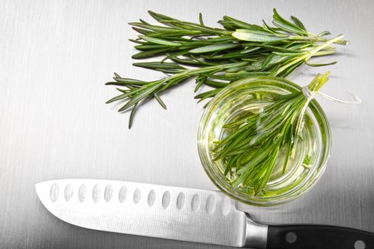 Rosemary leaves with cutting on stainless steel
