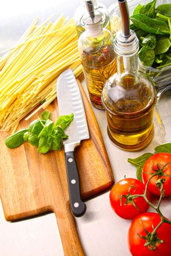 Preparation for making fettuccine with sauce and basil