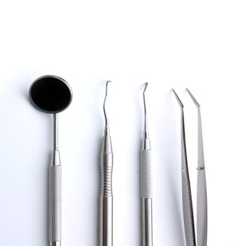 Close-up Dental Instruments on white background