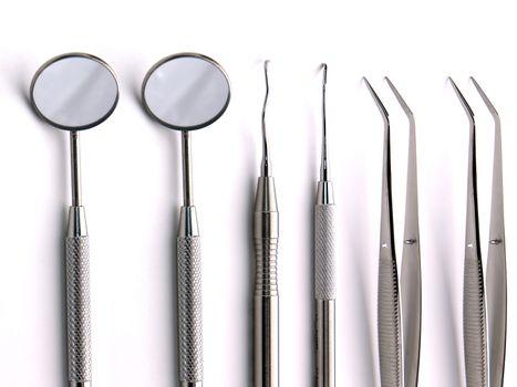 Close-up Dental Instruments on white background, metal, iron, steel, mirror