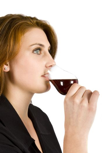 Beautiful young woman drinking red wine isolated