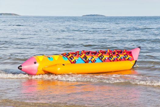Colorful banana boat with life jacket