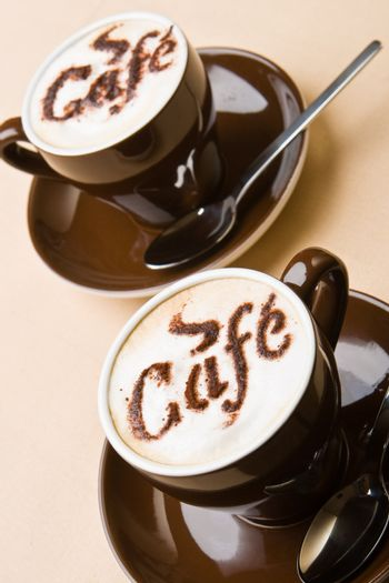 Two cups of fresh cappuccino