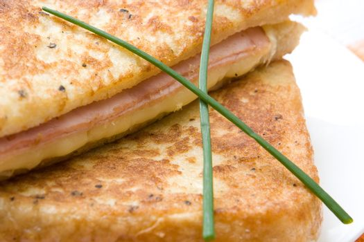 Toasted cheese and ham sandwiches with chives