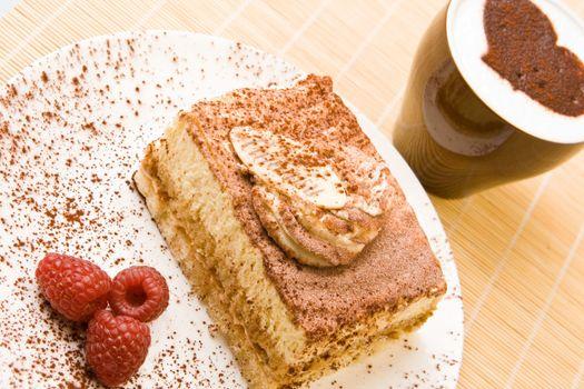 Delicious tiramisu with raspberries and cappuccino