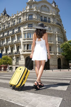 walking with suitcase on crosswalk