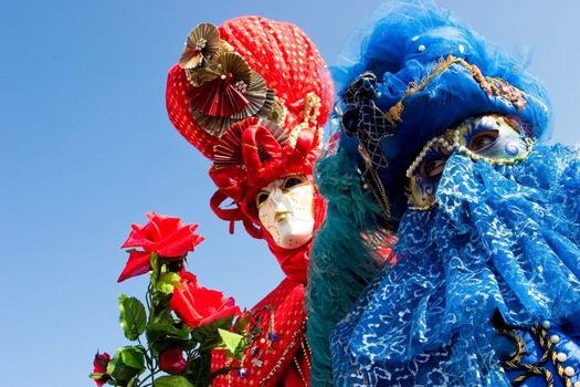 Two people in costume at the Venice Carnival