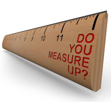 A wooden ruler with the words Do You Measure Up, symbolizing personal appraisal and assessment