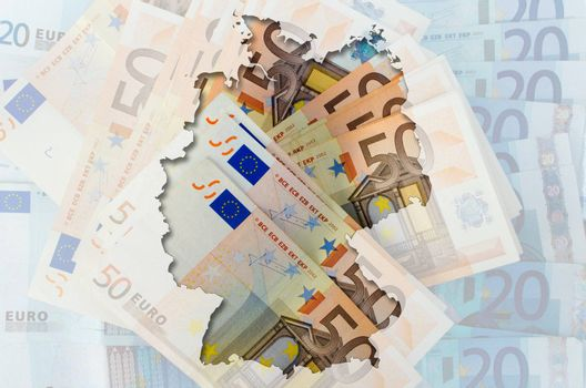 Outlined map of Germany with transparent background of euro banknotes