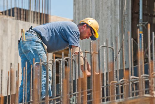 Construction worker busy with forwork frames