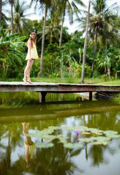 Girl near pond