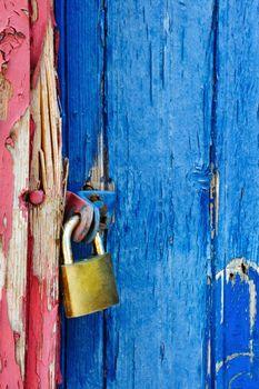 Padlock on highly textured door