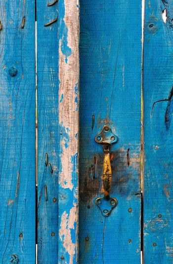 Highly textured blue wooden gate