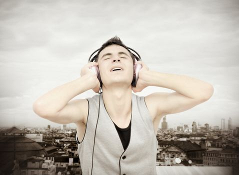 Teenager listening music on headphones :NOTE:Grain and texture was added